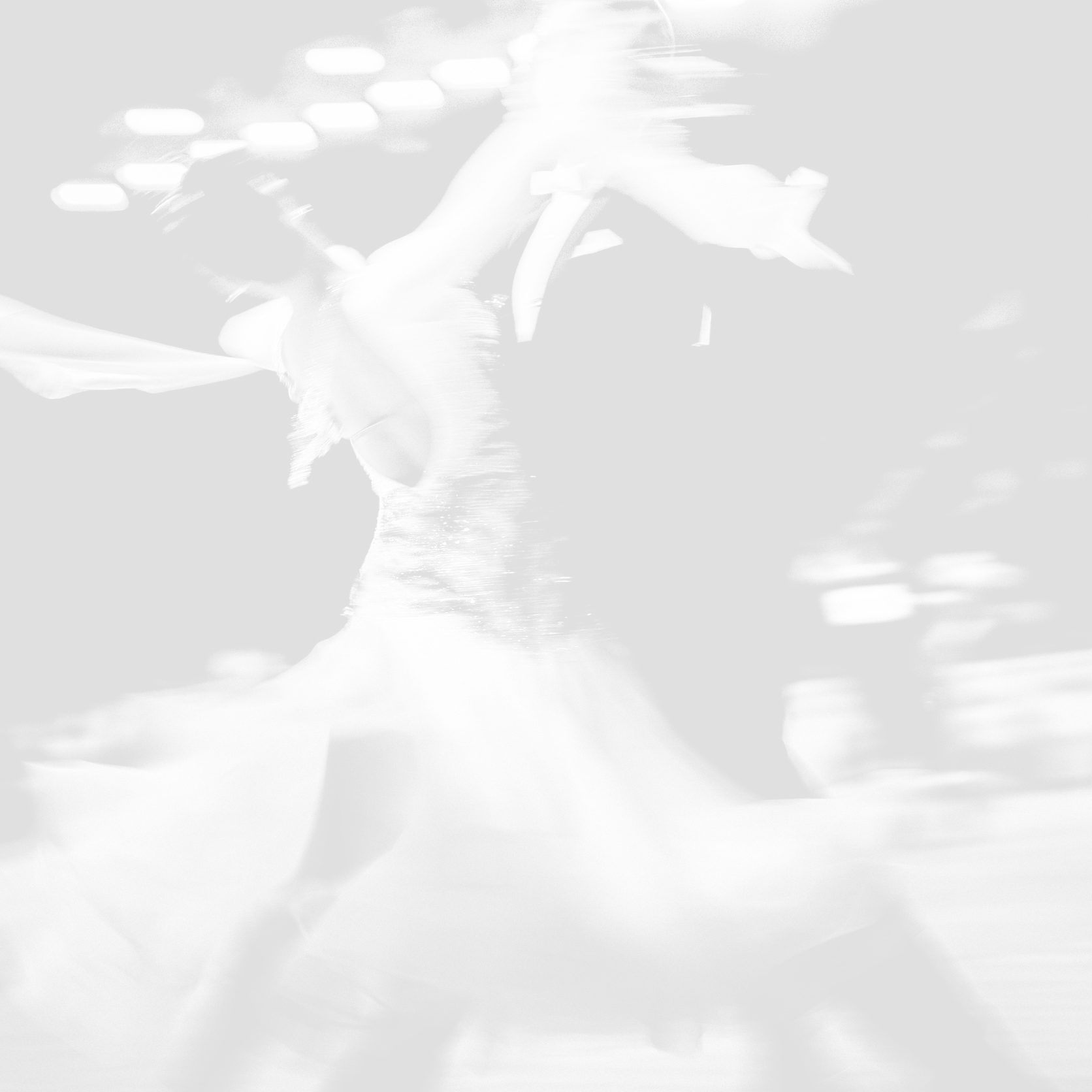 76368791 - blurred couple dancers competition in ballroom dancing. black and white image
