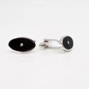 Oval black enamel cufflinks with crystal stud